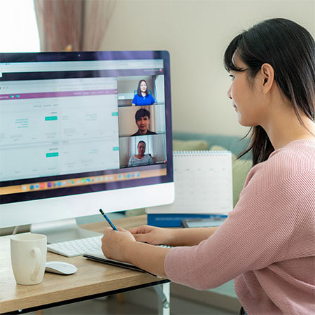 Woman in home office on video call